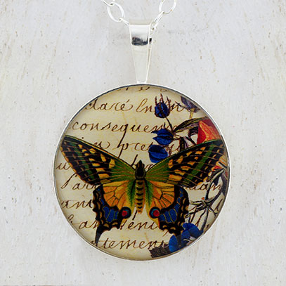 Butterfly with Flowers Sterling Pendant