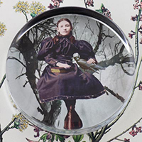 The Girl and the Raven Glass Round Paperweight